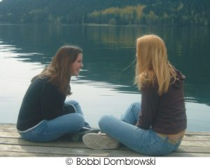 Two young women sharing faith