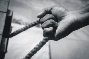 hand clinching a rope